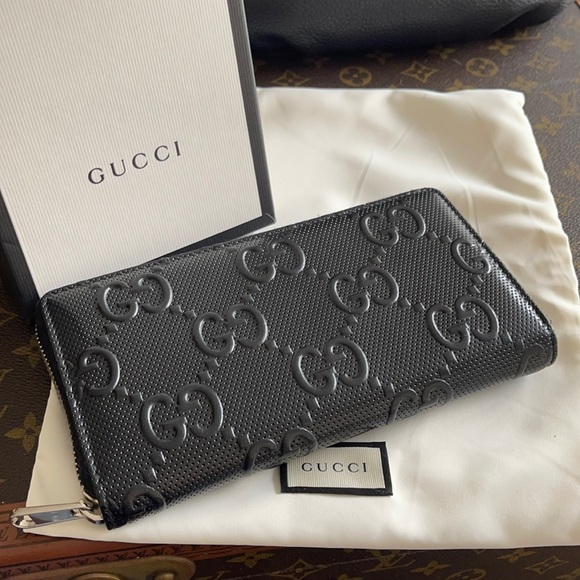 Authentic Gucci GG embossed zip around wallet case